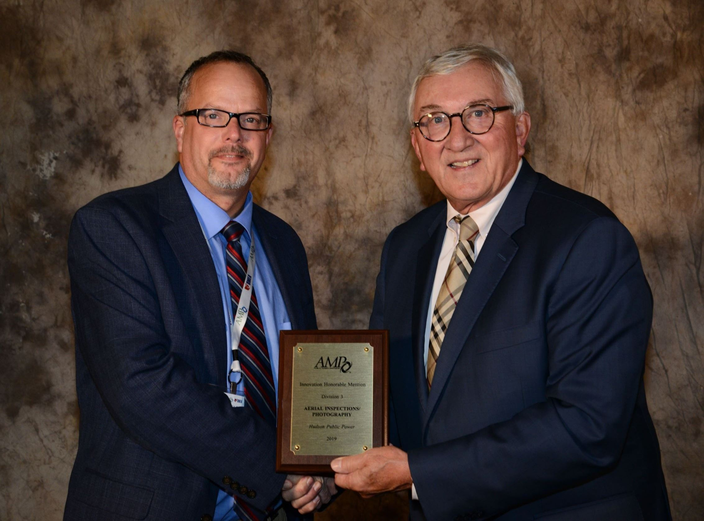 Frank Comeriato accepts AMP Awards 2019 for Hudson Public Power.